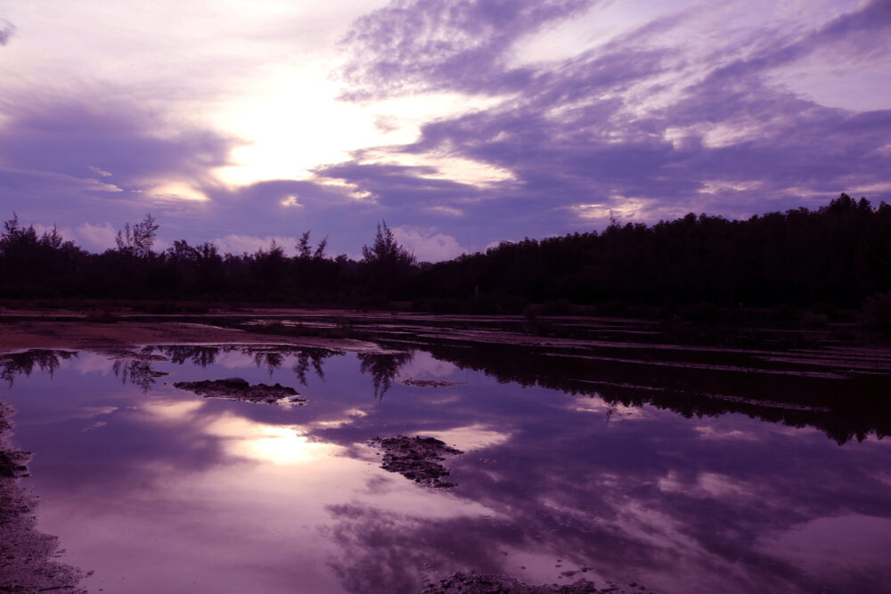 Mirror of purple sky in the morning reflection to the water