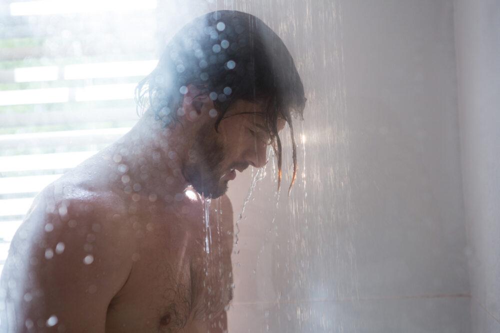 pixta_27428909_M Man taking a shower in bathroom