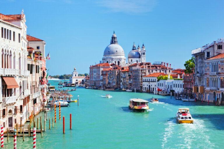 Venice, Italy. Grand Canal and Basilica Santa Maria della Salute at sunny day. View from Ponte dell Accademia