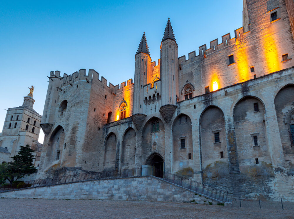 The building of the famous medieval papal palace at dawn. Avignon. France. Provence.