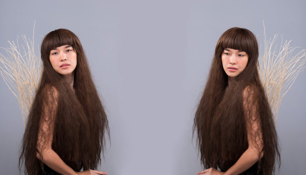 Hairy Girl portrait as lonely broken heart lady, Shampoo Haircare, Beauty salon, fashion, Hairdresser barber concept. Asian Naked Woman with Long Hair cover body feel express touching emotion