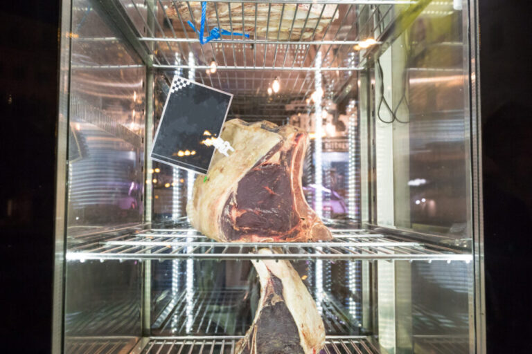 Display of Dry Aged Meat Steaks in butchers shop or restaurant in an display refrigerator