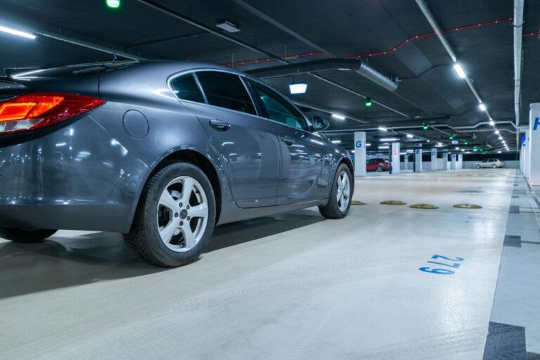 Parking lot. Car lot parking space in underground city garage. Empty road asphalt background. Ground floor for car parking